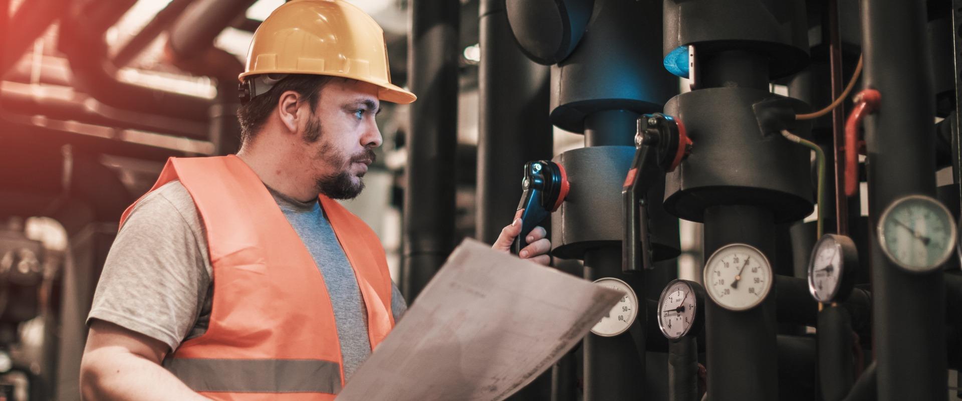 Boiler technician checking gauges